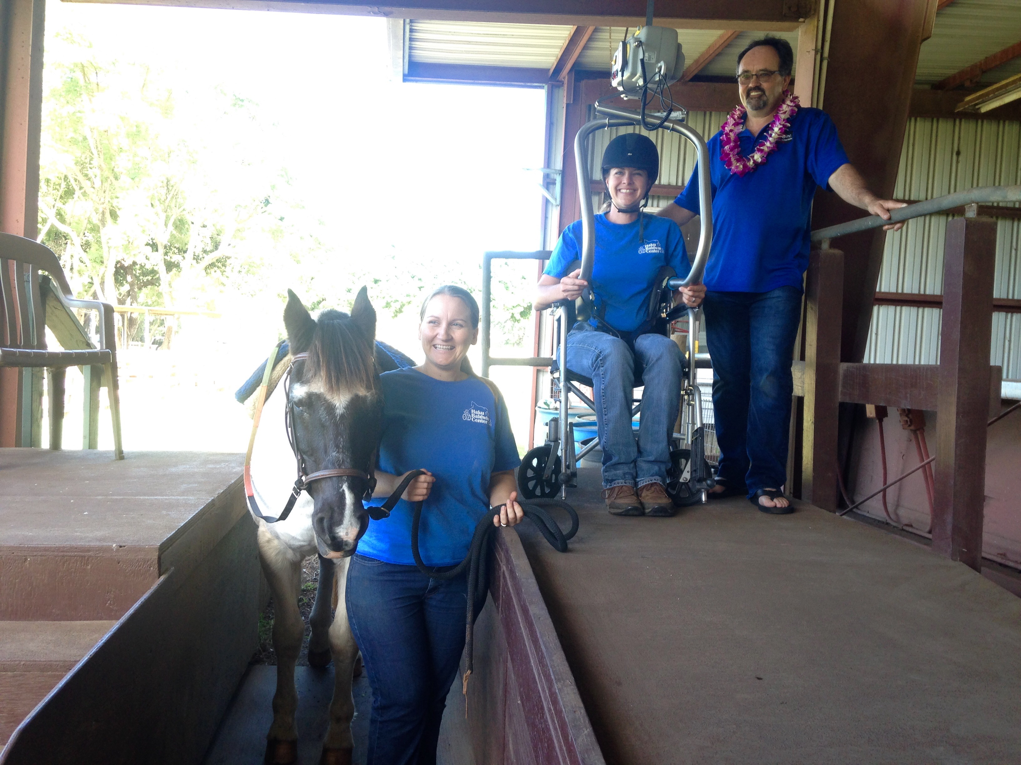 Craig Coogan (right), owner of Lift & Transfer Specialists, Inc., providing a training session for our staff on Tuesday. Shown here with Therapeutic Riding Program Director, Sarah Lyons (middle), Assistant Director, Chrissy Stout (left), and therapy horse, Apache.